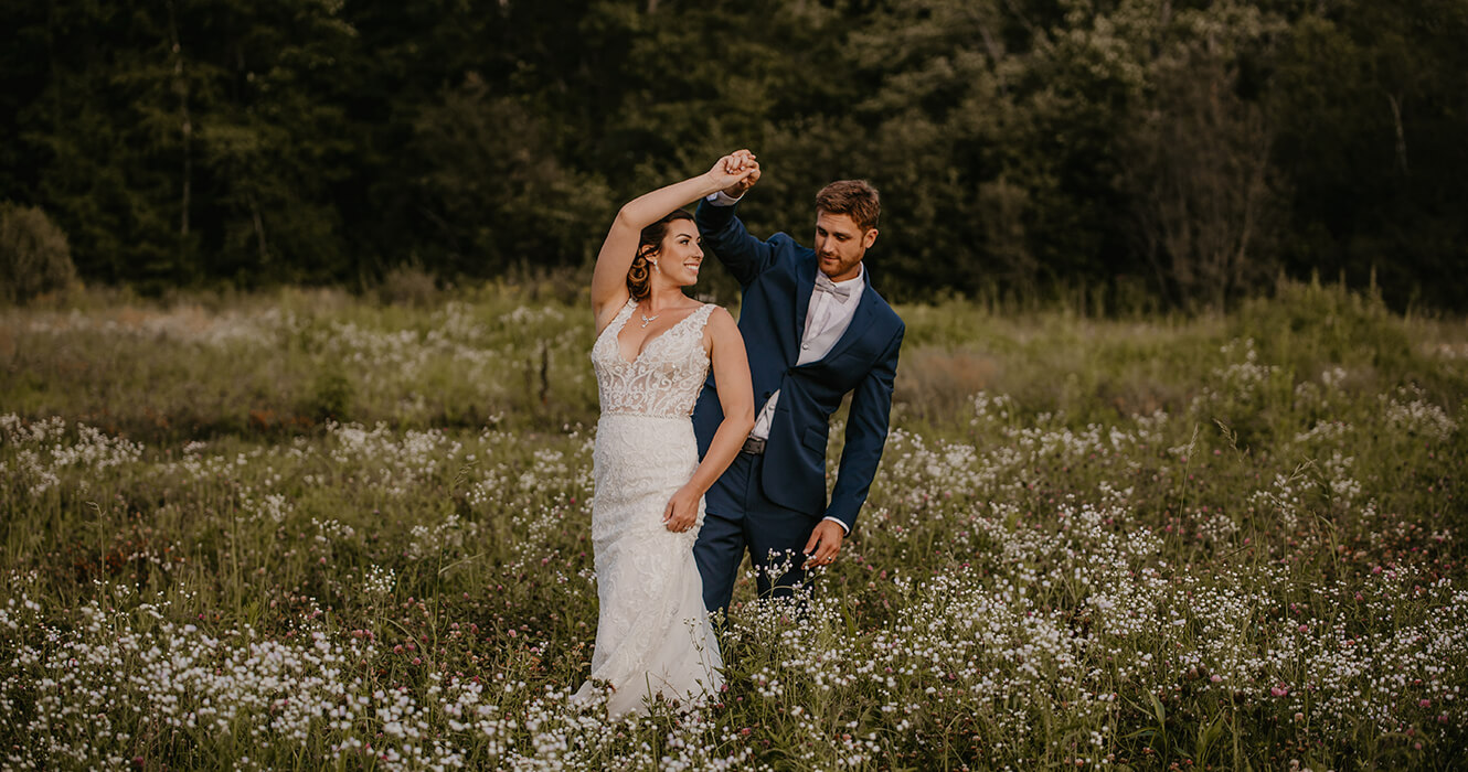 Dancing in the wildflowers at the Greenhouse Wedding Venue