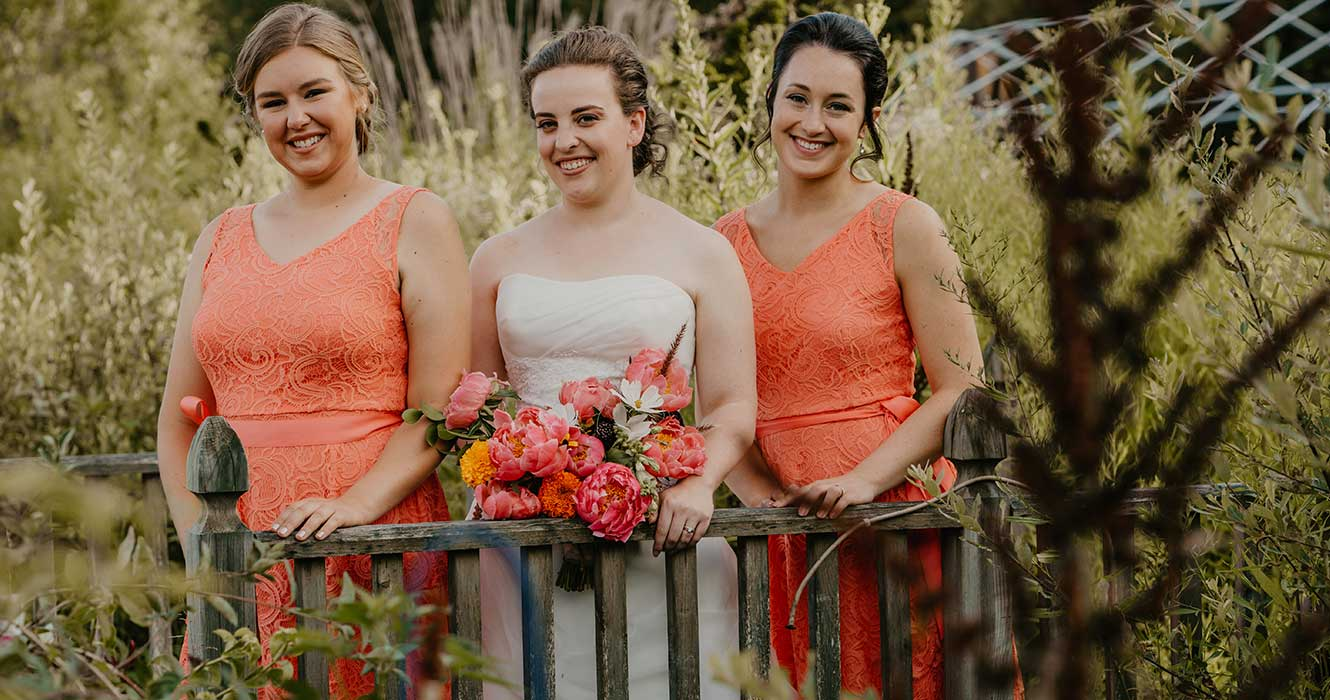 Bridal party in flower garden
