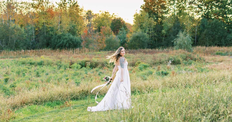 Bride in the field at wedding venue