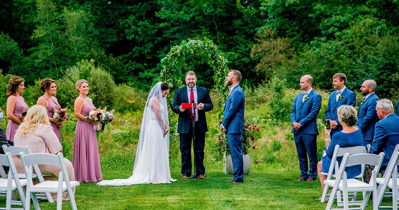 Couple reading vows at Maine wedding